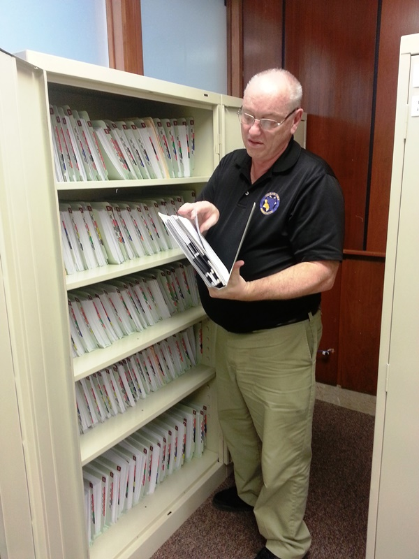 Clerk Checking Records