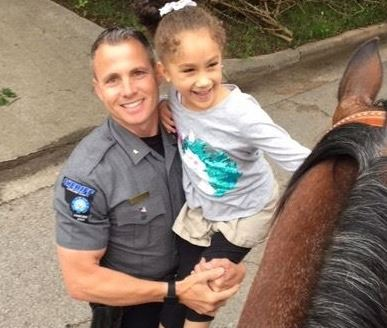 Sheriff with kid at parade
